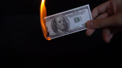 Dollar bill USA money burning in flames, economic crisis or inflation concept Stock Footage