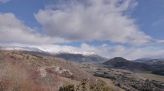 Snow on Mountains and dry valley Stock Footage