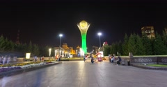 Evening Astana city, people walk near the monument Baiterek Stock Footage