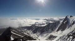 Time lapse of wickedly intense clouds roiling and flowing over peaks - stock footage