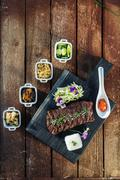 Korean BBQ with full side dishes, top view Stock Photos