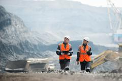Workers with coal at open pit Stock Photos