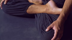 The man sitting in the lotus position Stock Footage