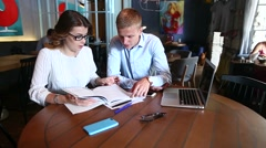 Young business team resolve issues leaf catalog Stock Footage
