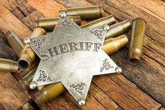 Sheriff badge and bullets shell Stock Photos