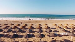 Sun umbrellas on the beach from the top aerial view Stock Footage