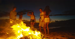 Friends Dancing at Bonfire Beach Party Stock Footage