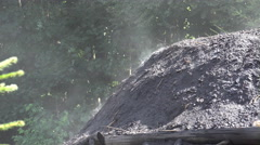 4k Charcoal burner close up smoking charcoal pile scenery Stock Footage