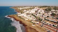 Beach of Praia da Luz at morning, Lagos, Algarve, Portugal aerial view Stock Footage