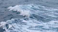 Water surface behind of fast moving motor boat Stock Footage