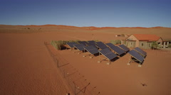 Aerial shot of solar panels and house in desert - Namibia Stock Footage