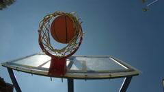 Ball falls through basketball hoop Stock Footage