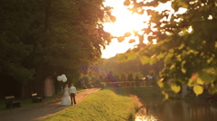 Beautiful wedding couple with balloons walking at the picturesque golden autumn Stock Footage