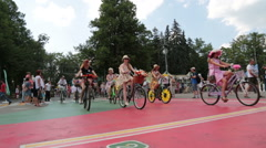 Ladies Cycling in the Park (Ladies in Exotic) Stock Footage