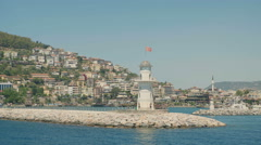 Lighthouse in the port of Alanya, Turkey. Beautiful summer landscape with sea - stock footage