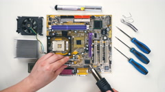 Top view of Comuter electronics repair with soldering Iron. Stock Footage