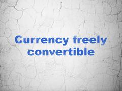 Currency concept: Currency freely Convertible on wall background - stock illustration