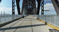 Bicyclist Rides in Front of Tracking Camera Big Four Bridge Louisville Stock Footage