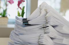 Many stack of white document - stock photo