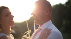Tender moment of embracing between young couple on wedding day. Bride and groom - stock footage