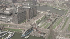 Aerial of cityscape and ship passing under bridge Stock Footage