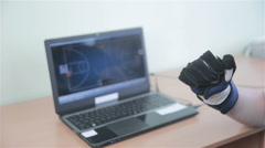 Electronic high-tech cyber glove. Man plays VR game operating with 3D bionic - stock footage