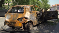 Burned car. the interior of an car damaged. From rear Stock Footage