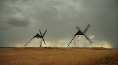 Windmills of Castilla la Mancha, Spain. Windmills at Consuegra at storm Stock Footage