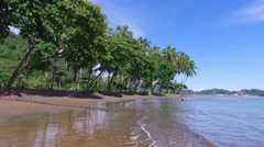 Tropical setting on the beach in Costa Rica Stock Footage