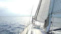 Woman is checking her big sailboat on the sea Stock Footage