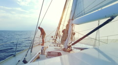 Man is checking his big sailboat on the sea Stock Footage