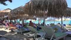 Vacationers on sunbeds at Pefkohori beach. Kassandra, Chalcidice, Greece Stock Footage
