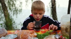Kid drinking tea outdoors Stock Footage