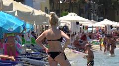 Crowd of tourists on the Pefkohori beach. Kassandra, Chalcidice, Greece Stock Footage