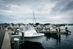 Boats and docks in the harbor of Hyannis, Cape Cod, Massachusetts. Stock Photos