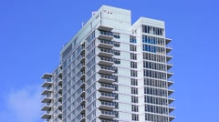 High rise condominium and blue sky Stock Footage