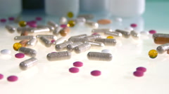 Different pills and cans on white table with camera slides Stock Footage