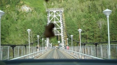 the car rides on a narrow bridge - stock footage