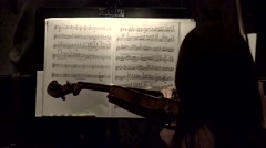 Playing the violin in a symphony orchestra. Stock Footage