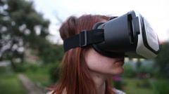 Young woman uses VR helmet with head mount display Stock Footage