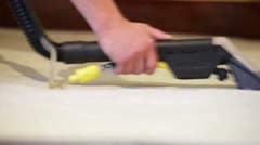Vacuum cleaning couch, close-up Stock Footage