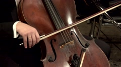 Playing  string instruments (cello)  in a symphony orchestra. Stock Footage