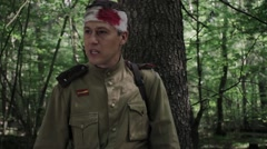 Wounded Soviet soldier emotionally speaks standing in the woods. World War II. Arkistovideo
