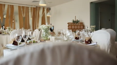 Table set in white decoration for wedding or another catered event dinner Stock Footage