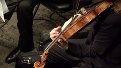 Playing  string instruments (viola) in a symphony orchestra. Stock Footage