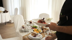 The waiter serves rustic wedding table with white decoration, close-up Stock Footage