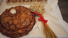 Traditional tasty ukrainian wedding bread loaf at the wedding table Stock Footage