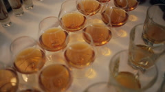 Top view of glasses with different alcohol drinks on a table at wedding Stock Footage