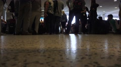People walking, feet in busy air terminal, silhouette of terminal passengers  Stock Footage