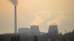 Silhouette with tubes factory, from which the smoke is at sunrise, sunset Stock Footage